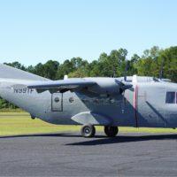 Photo of a grey Casa 212 tailgate aircraft