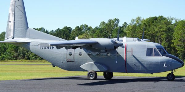 Photo of a grey Casa 212 tailgate aircraft