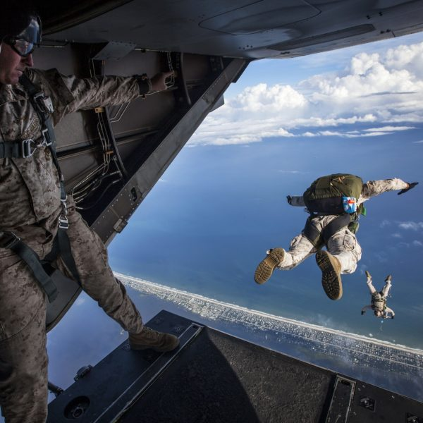 Military skydiver exits from the back of a Casa212