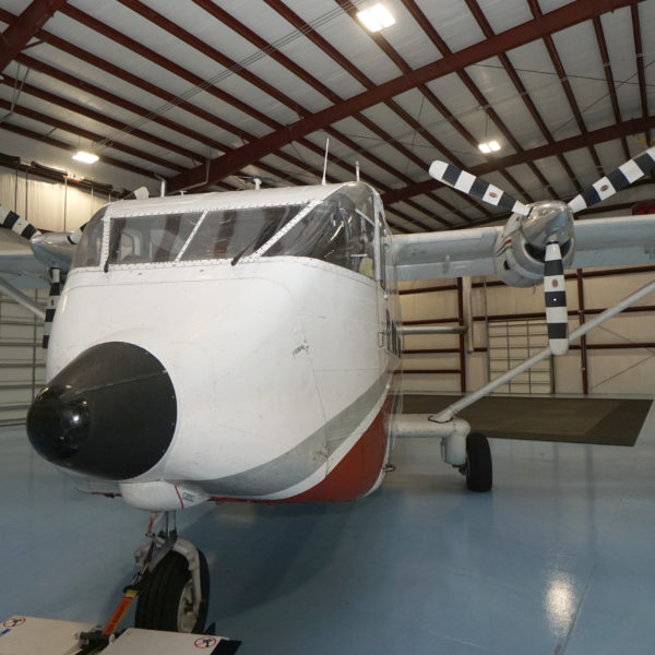 Shorts Skyvan parked in a well-lit hangar.